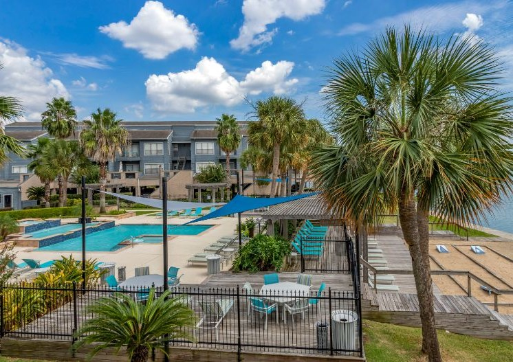 Aerial view with palm trees, pool, pool furniture, and palm trees