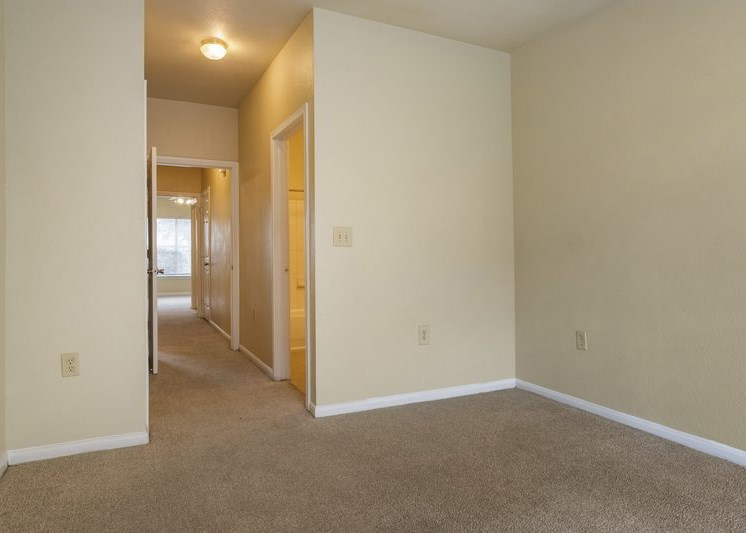 View of hallway with cream colored walls and carpet flooring
