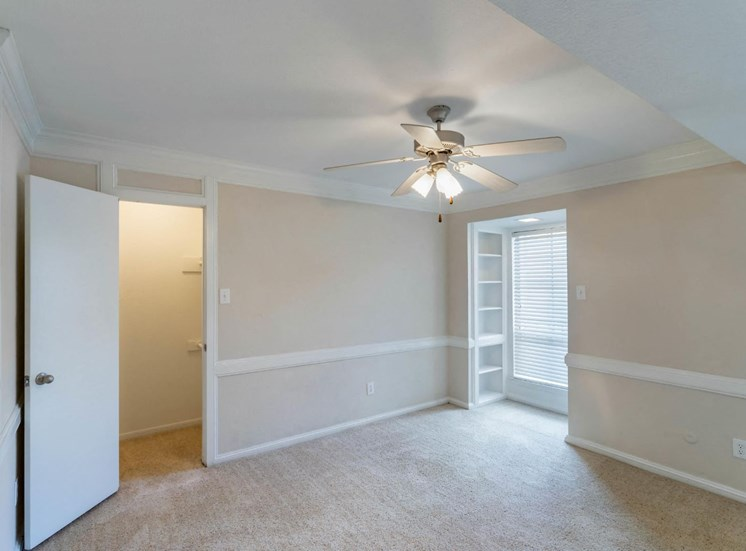 Bedroom with Ceiling Fan and Crown Molding