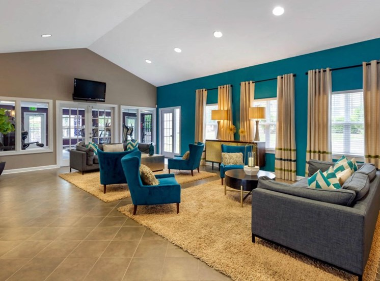 Clubhouse Seating Area with Gold and Blue Accents
