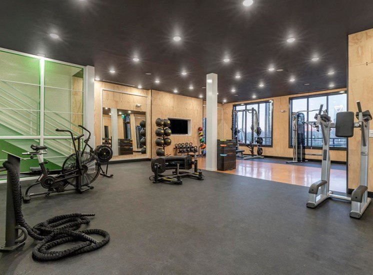 Fitness center with equipment such as ab machine bicycle and medicine balls