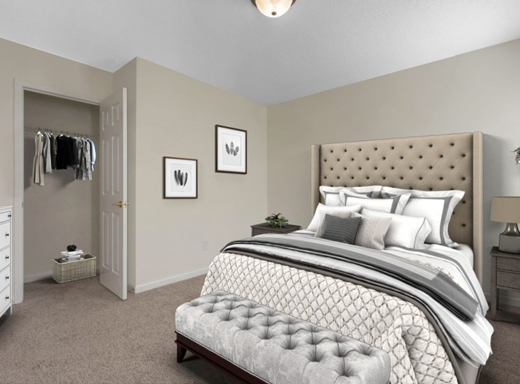 Carpeted Bedroom with Virtually Staged Bed, Nightstand and Chest of Drawers Next to Closet
