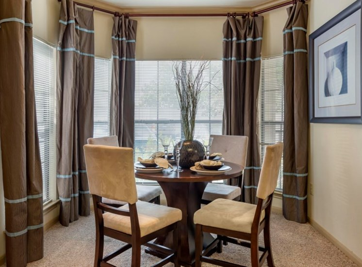 Furnished Model Dining Room with Table and Chairs
