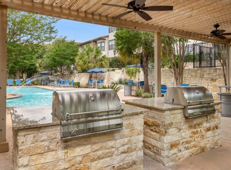 Poolside Deck with Summer Kitchen Grills Under Pergola