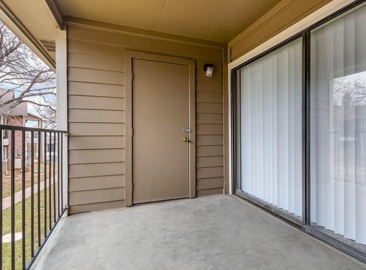 Balcony with sliding door and storage door
