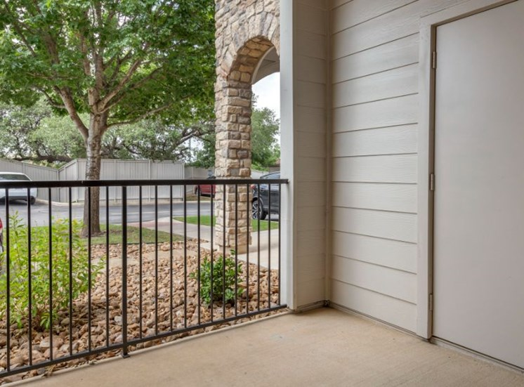 Private Patio with Outside Storage and Metal Railing