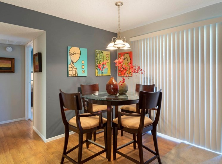 Dining Room with round table, chairs, and a blue accent wall