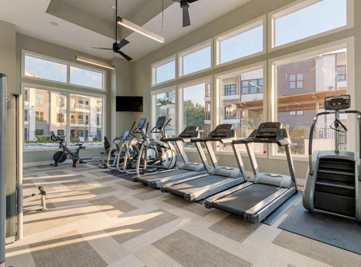 Cardio and Fitness Center with Exercise Equipment Next to Window