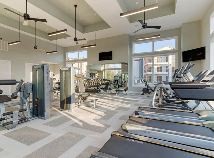 Cardio and Fitness Center with Fans and Windows