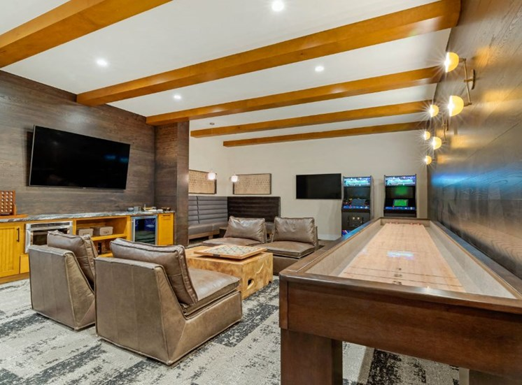 Resident Lounge with Shuffleboard Table Mounted TV and Arcade Games