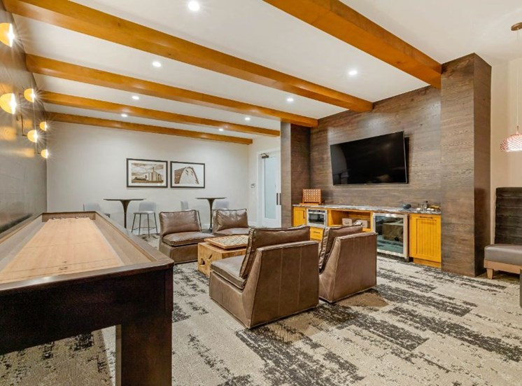 Resident Lounge with Shuffleboard Table Mounted TV