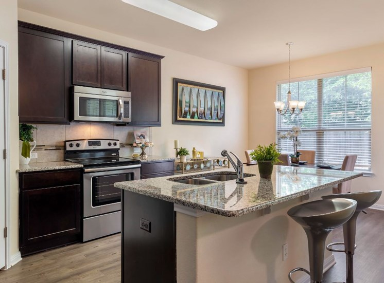 Fully Equipped Kitchen with Stainless Steel Appliances and Double Basin Sink