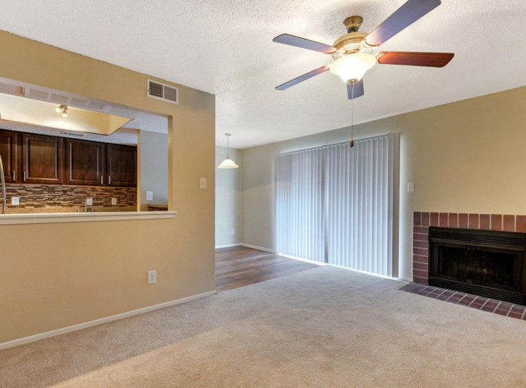 Living Room with Ceiling Fan and Fireplace