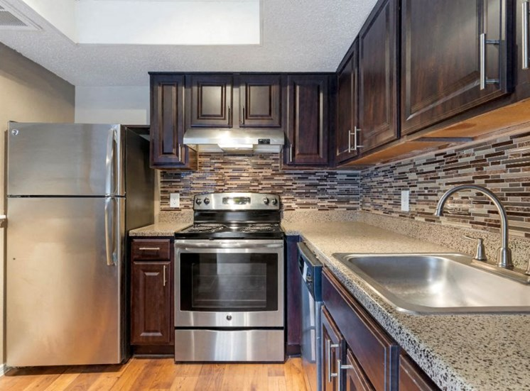 Fully equipped kitchen with double basin sink and hardwood style floors