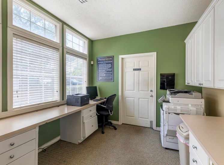 Business Center with green accent wall, white cabinets, desks,  and computers