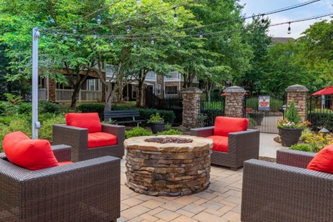 Fire Pit with Patio Armchairs with Red Cushions