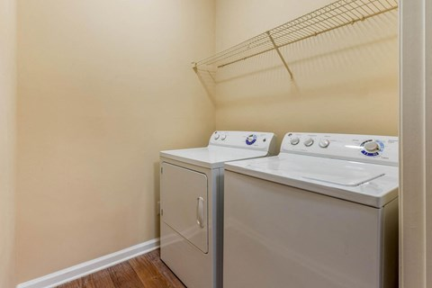 Full Size Washer and Dryer in Utility Closet Under Wire Shelf