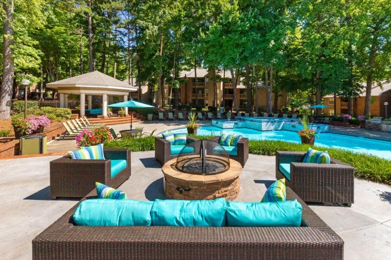 Poolside Fire Pit Surrounded By Patio  Couches