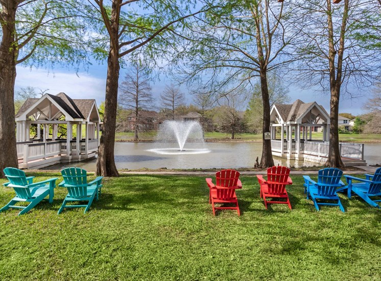 Lounge Chairs By Waterfront with Docks and Water Feature