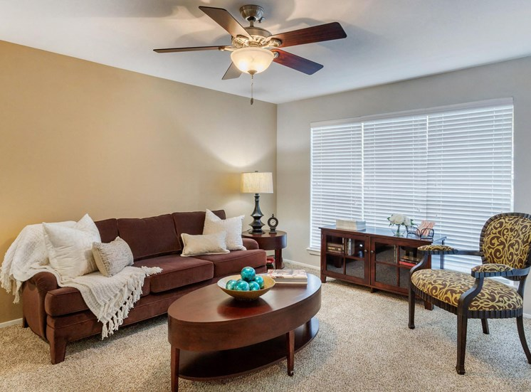 Spacious Model Living Room with Couch Coffee Table and Chair