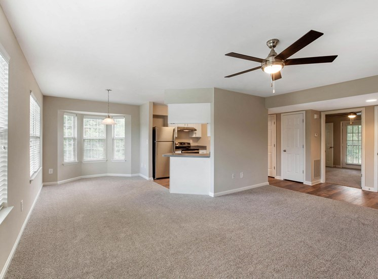 Spacious Floor Plan with Open Kitchen Breakfast Bar to Carpeted Living and Dining Rooms