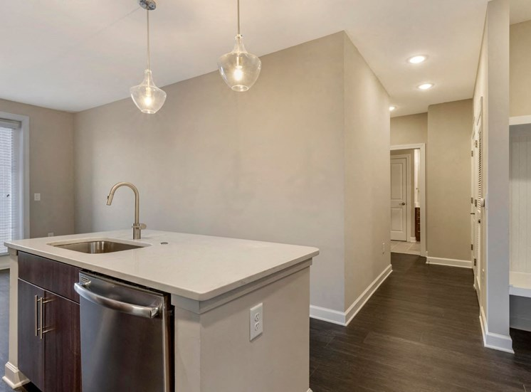 Open Layout Floor Plan with Kitchen Island with Stainless Steel Dishwasher