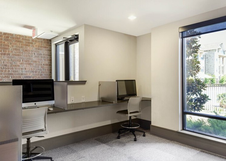 Business center with a computer, desk, and chair