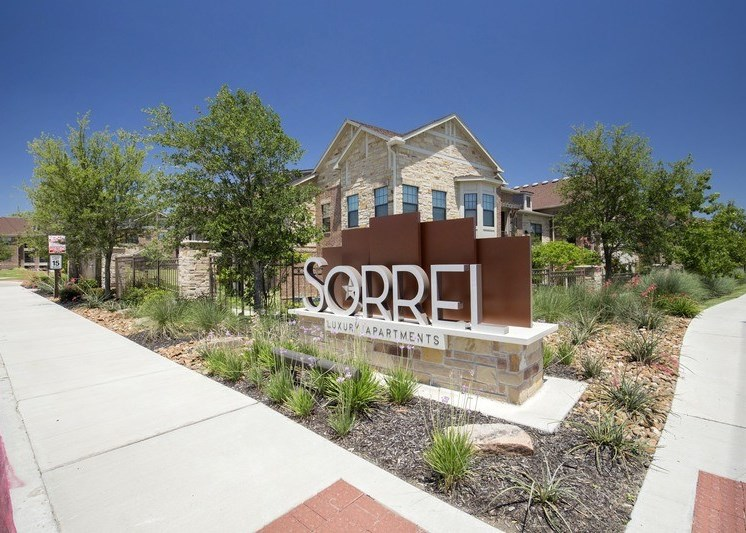 Front entrance sign with landscaping