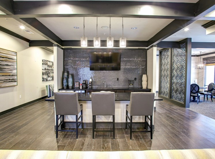 Clubhouse kitchen with a kitchen island and bar stool chairs