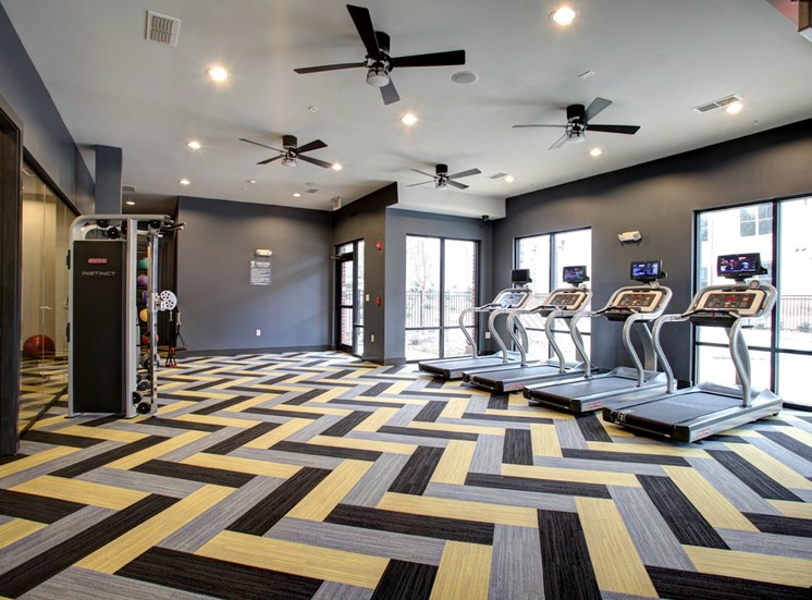 Fitness Center with Exercise Equipment and ceiling fans