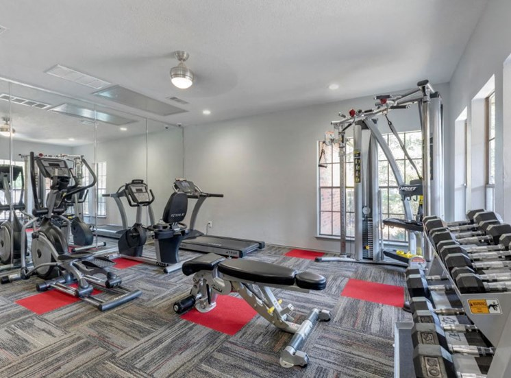 Fitness Center with treadmills, free weights, and workout stations