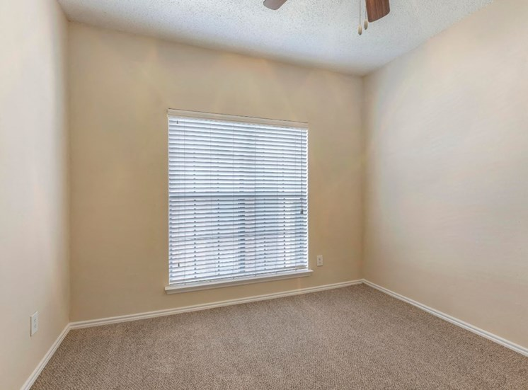 Bedroom with Ceiling Fan and Wall-to-Wall Carpet