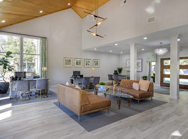 Clubhouse Seating Area with Couches Coffee Table and Wood Ceiling