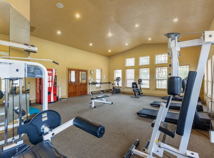 Fitness center with treadmills and a workout station