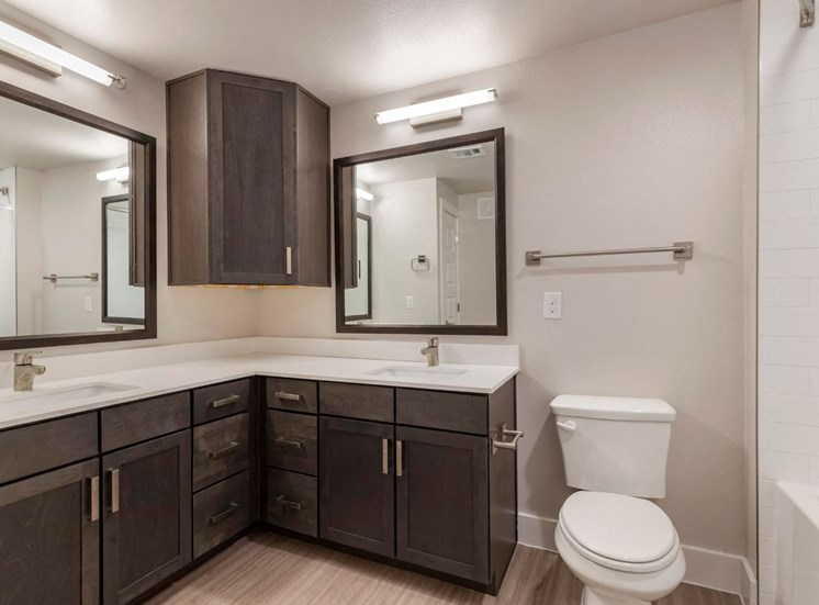 Bathroom with Double Vanity Dark Wood Cabinets and White Counters