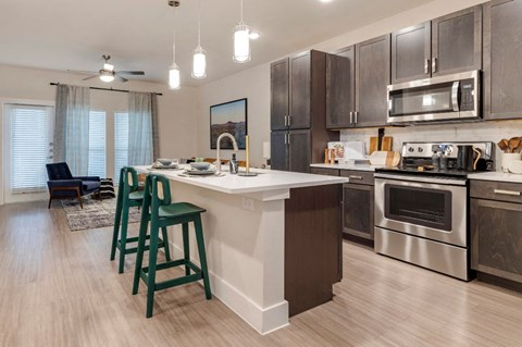 Fully Equipped Kitchen with Island and Brushed Nickel Appliances