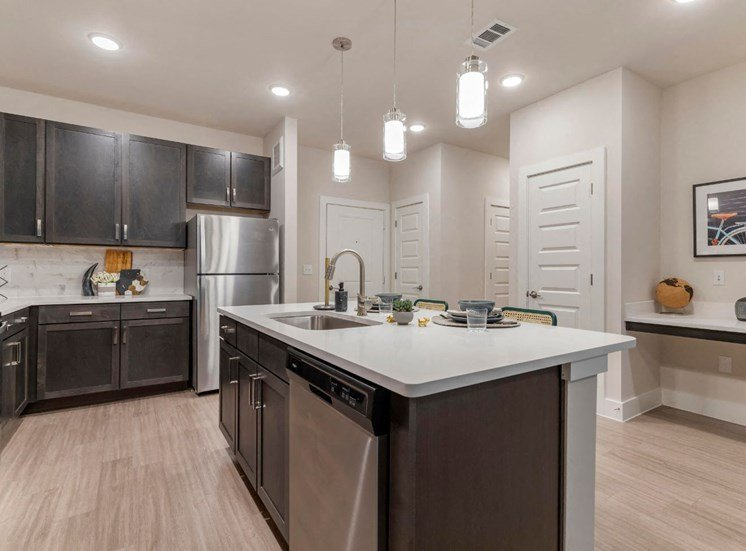 Fully Equipped Model Kitchen with Island and Brushed Nickel Appliances