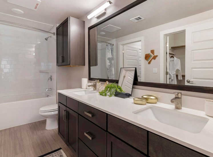 Model Bathroom with Double Vanity and Garden Style Tub