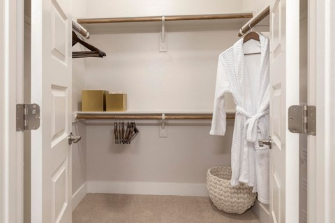 Walk-In Closet Space with Built In Shelves