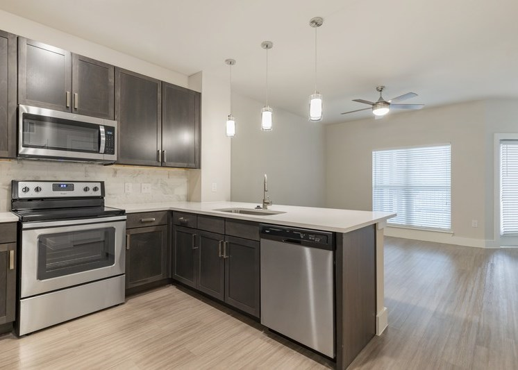 Fully equipped kitchen with view of dining room