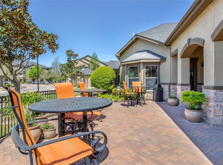 Clubhouse Outdoor Seating with Orange Cushions