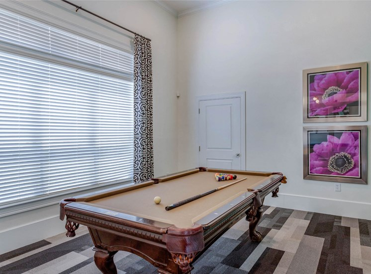 Clubhouse Game Room with Billiards Table and Art on the Walls