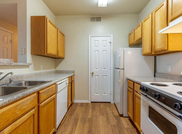 Fully equipped kitchen with large counter space, electric stove, and wooden cabinetry
