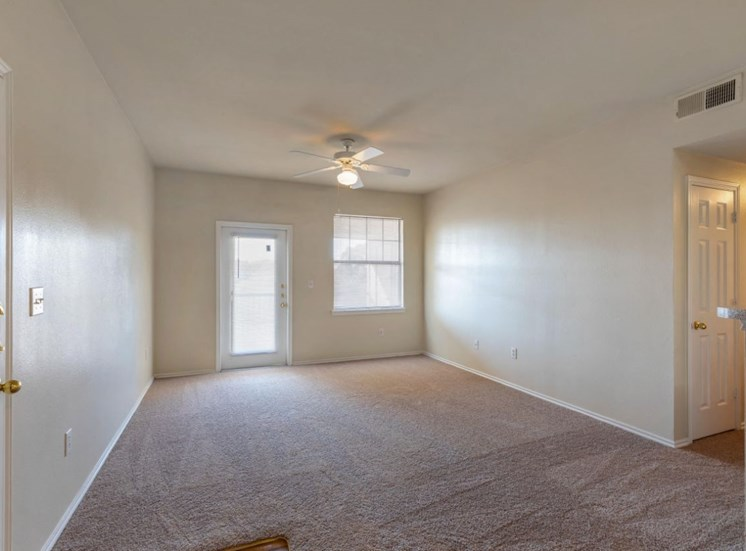 Living Room with Wall to Wall Carpet, Ceiling Fan, lights, and Window
