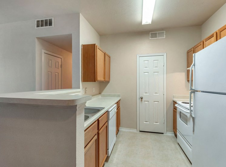 Fully Equipped Kitchen with Breakfast Bar, pantry, and white appliances