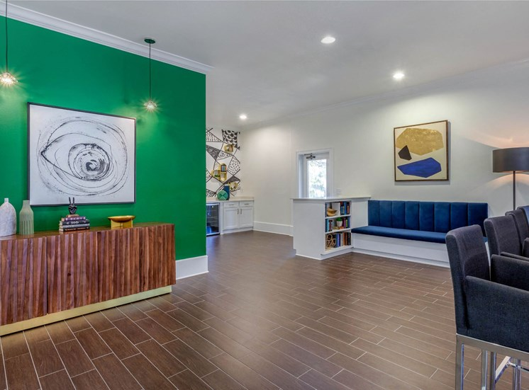 Clubhouse Lounge Area with Green Accent Wall, Seating and Decorations
