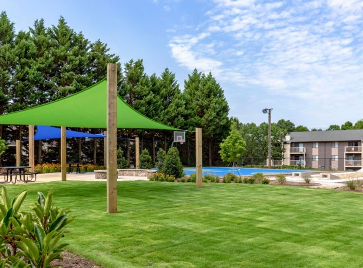Poolside Picnic Tables Covered By Bright Shade Sails
