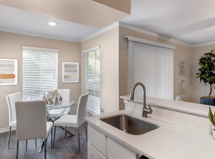 Kitchen with White Counter and Dining Room with Dining Table