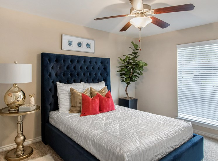 Spacious Model Bedroom with Bed Nightstand and Tree