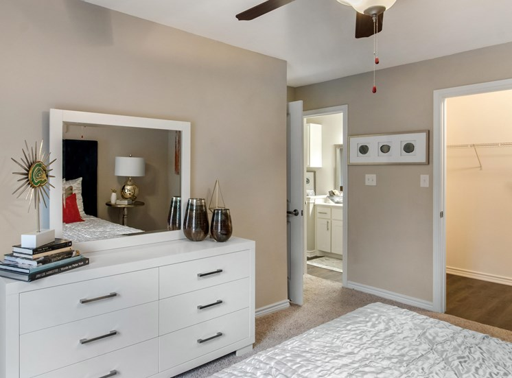 Bedroom with Virtually Staged Dresser and Decorations with En Suite Bathroom and Walk in Closet